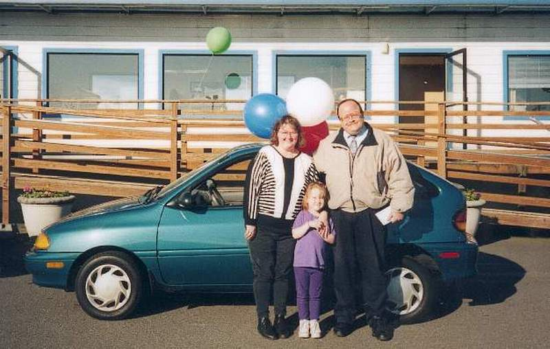 "Maureen, Shawna and Jim with Mo's ""new"" 94' Ford Aspire"